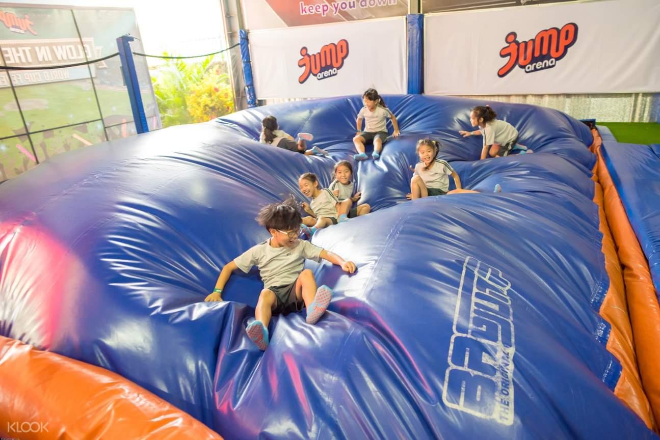 tourists enjoy the foam pit in jump arena vietnam